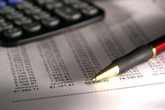 Financial Spreadsheet with Pen and Calculator stock image