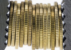 Financial squeeze. Coins squeezed by a clamp on white background Royalty Free Stock Photos