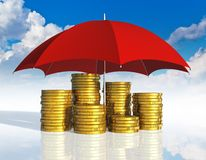 Financial stability and business success concept. Financial stability, business success and insurance concept: stacked golden coins covered by red umbrella