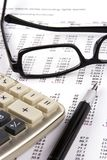 Financial Statement. With calculator, eyeglasses and fountain pen Stock Photo