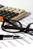 Financial Statement. With calculator, eyeglasses and fountain pen Stock Photos