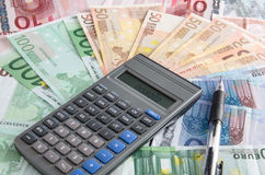 Financial statement. A calculator on many hundreds bank notes Royalty Free Stock Images