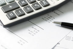 Financial statement with calculator and pen Royalty Free Stock Photos