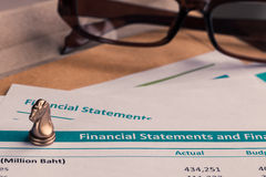 Financial statement letter on brown envelope and eyeglass, busin Royalty Free Stock Image