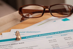 Financial statement letter on brown envelope and eyeglass Royalty Free Stock Photo
