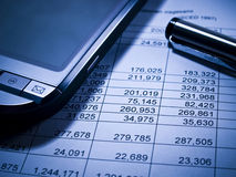 Financial statement and PDA royalty free stock photo