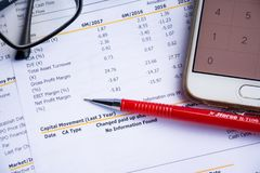 Financial statement read and check the number for analysis. With red pen stock photo