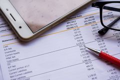 Financial statement read and check the number for analysis. With red pen stock images