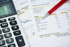 Financial statement read and check the number for analysis. With red pen royalty free stock photo