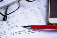 Financial statement read and check the number for analysis. With red pen stock photos