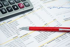 Financial statement read and check the number for analysis. With red pen royalty free stock image