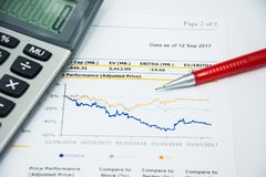 Financial statement read and check the number for analysis. With red pen royalty free stock photos