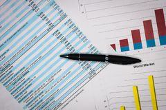 Financial statements review and analyze with colorful charts and tables. stock photo