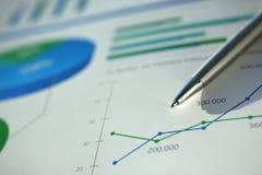 Financial statistics documents ball pen infographics stock photos