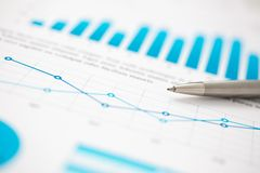 Financial statistics documents ball pen infographics at office table. Closeup. Internal Revenue Service inspector sum check, investigation, exchange market Royalty Free Stock Photos