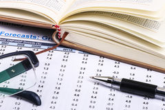 Financial statistics and report. On paper Royalty Free Stock Image