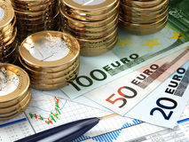 Financial stock market concept. Euro banknotes and coins. Stock Photo