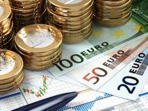 Financial stock market concept. Euro banknotes and coins. Stock Photo