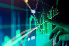 Financial Stock Market Data. A city worker Analysing illustrated stock market financial  data on a screen Royalty Free Stock Photos