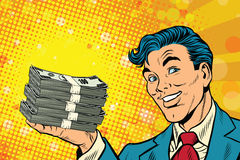 Financial success businessman with money. Pop art retro comic book illustration. Lottery and cash prize Royalty Free Stock Images