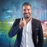 Financial success of a businessman. Businessman optimistic for world success financial growth Royalty Free Stock Photo