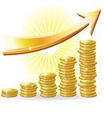 Financial success concept. Golden arrow and the diagram of the coins Royalty Free Stock Photography