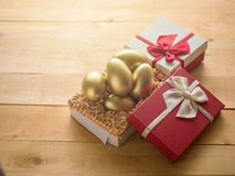 Financial success. Golden egg In a red gift box Royalty Free Stock Photos