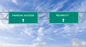 Financial success and reliability. Road sign to financial success and reliability Stock Images