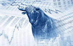 Financial symbols and bull. Stand for success in the stock market Royalty Free Stock Image
