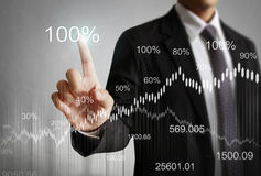 Financial symbols coming from han. Businessman with financial symbols coming from han Royalty Free Stock Photo