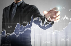 Financial symbols coming from han. Businessman with financial symbols coming from han Stock Photography