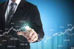 Financial symbols coming from han. Businessman with financial symbols coming from han Stock Photo