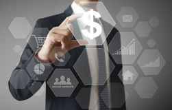 Financial symbols coming from han. Businessman with financial symbols coming from han Stock Images