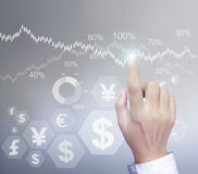 Financial symbols coming from hand Stock Images
