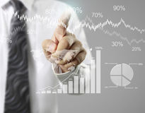 Financial symbols coming from hand Royalty Free Stock Images