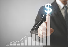 Financial symbols coming from hand Royalty Free Stock Image