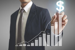 Financial symbols coming from hand Stock Photography
