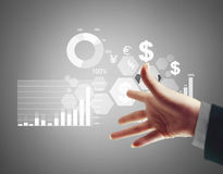 Financial symbols coming from hand. Businessman with financial symbols coming from hand Royalty Free Stock Photos