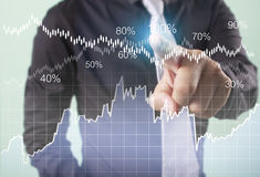 Financial symbols coming from hand. Businessman with financial symbols coming from hand Stock Photo