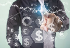 Financial symbols coming from hand Stock Photos
