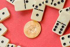 Chaos. Finance system error. destroyed dominoes with golden bitcoin. Royalty Free Stock Image