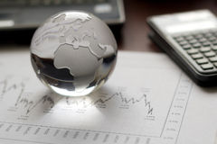 Financial table setting. Financial planning with glass globe stock images
