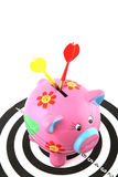 Financial Target. Piggy bank on a dart board hits by bulls eye Royalty Free Stock Photos
