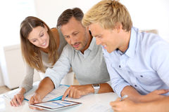 Financial team checking graphs in office Royalty Free Stock Photo