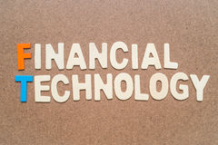 Financial Technology wording on brown background Royalty Free Stock Photo
