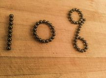 A financial ten percent symbol in magnetic ball bearings royalty free stock photography