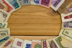 Financial themed frame with worldwide currencies Stock Image