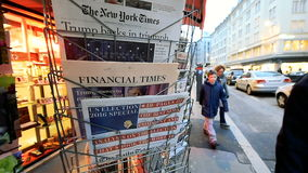 Financial Time newspapers about Donald Trump new USA president. PARIS, FRANCE - NOV 10, 2016: Man buying Financial Times newspaper with shocking headline title stock video