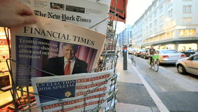 Financial Time newspapers about Donald Trump new USA president. PARIS, FRANCE - NOV 10, 2016: Man buying Financial Times newspaper with shocking headline title stock footage