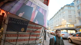Financial Times about Donald Trump new USA president. PARIS, FRANCE - NOV 10, 2016: Man buying Financial Times newspaper with shocking headline title at press stock footage